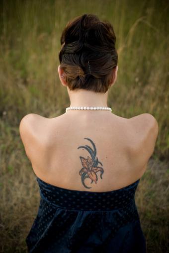 https://cf.ltkcdn.net/tattoos/images/slide/141361-566x848r1-single-orchid.jpg