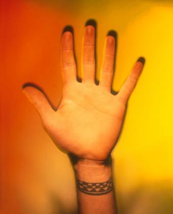 https://cf.ltkcdn.net/tattoos/images/slide/144689-624x769r1-charm-bracelet.jpg