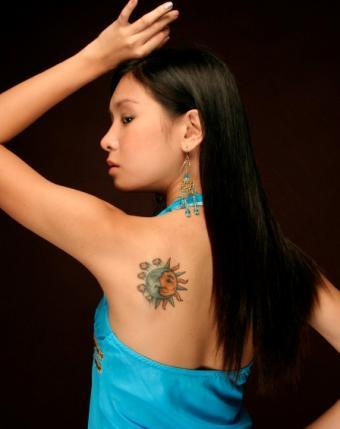 https://cf.ltkcdn.net/tattoos/images/slide/155715-448x565-sun-moon-yin-yang.jpg