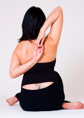 https://cf.ltkcdn.net/tattoos/images/slide/155720-472x662r1-low-back-yin-yang.jpg