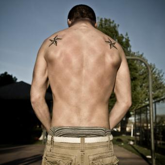 Two nautical star tattoos