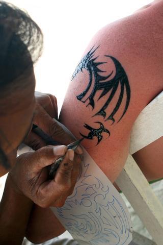 Creating a dragon henna tattoo design; © Tatiana Belova   Dreamstime.com