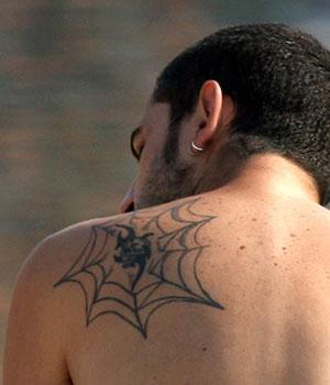 Shoulder spider web tattoo