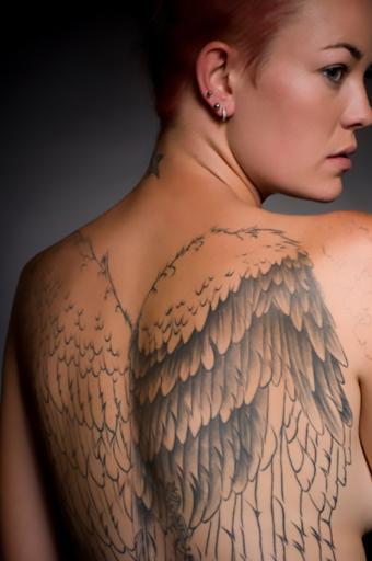 https://cf.ltkcdn.net/tattoos/images/slide/178107-565x850-Angel-wings-2.jpg