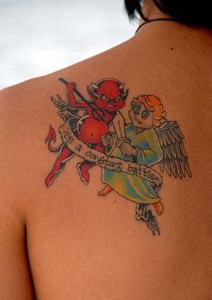 Angel and Devil Battle Tattoo