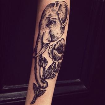https://cf.ltkcdn.net/tattoos/images/slide/180035-610x609-elephant-with-flower-tattoo.jpg