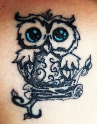 https://cf.ltkcdn.net/tattoos/images/slide/182399-668x850-baby-owl.jpg