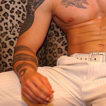 Snake tattoo wrapped around the arm