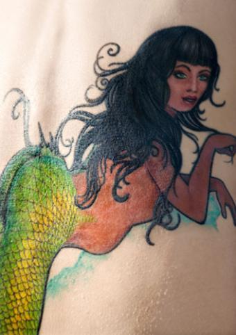 Close-up of mermaid tattoo