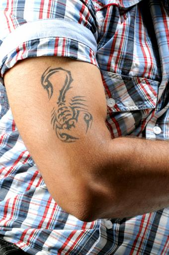 https://cf.ltkcdn.net/tattoos/images/slide/189632-564x850-scorpion-tattoo.jpg