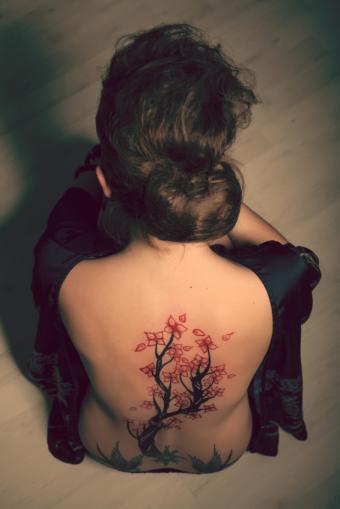 Geisha with tattoo on back