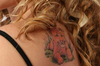 Lion on shoulder tattoo