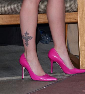 Drew Barrymore's cross tattoo on ankle