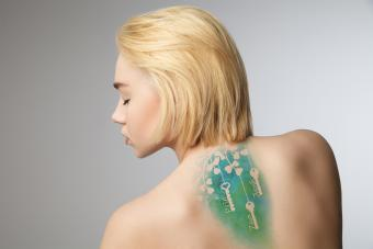 https://cf.ltkcdn.net/tattoos/images/slide/214838-850x567-watercolorkeystattoo.jpg