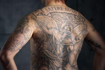 https://cf.ltkcdn.net/tattoos/images/slide/217874-850x567-Michael_and_the_Dragon_backpiece.jpg