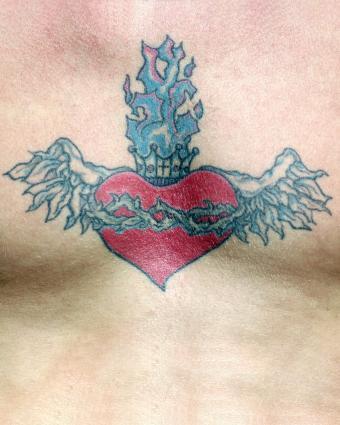 https://cf.ltkcdn.net/tattoos/images/slide/218066-680x850-heartandcrowntat.jpg