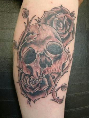 Tattoo of skull and roses