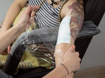 wrapping up tattoo client