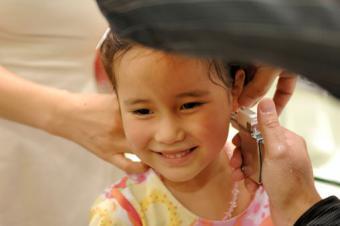 Girl getting ears pierced