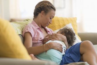 mother nursing daughter