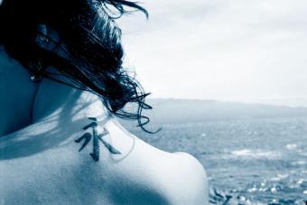 https://cf.ltkcdn.net/tattoos/images/slide/224543-850x567-water-symbol-tattoo.jpg