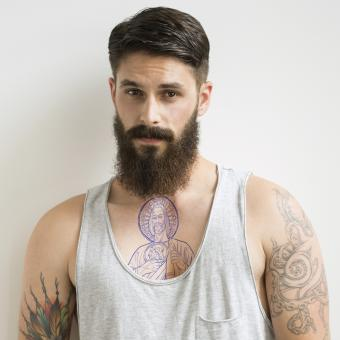 Hipster with St. Jude outline tattoo