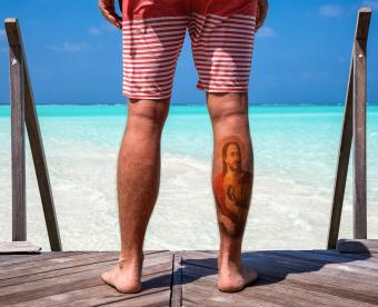 St. Jude portrait tattoo on calf