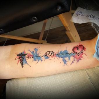 Doy-Ortega-RN-tattoo.jpg