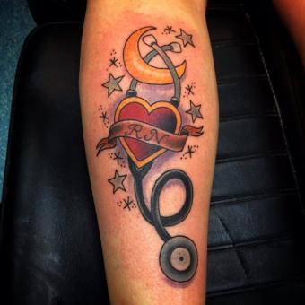 RN heart shape and stethascope tattoo