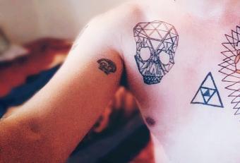 Man with polygonal skull tattoo