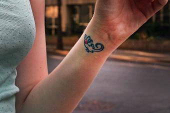 https://cf.ltkcdn.net/tattoos/images/slide/234619-850x566-6-lizard.jpg