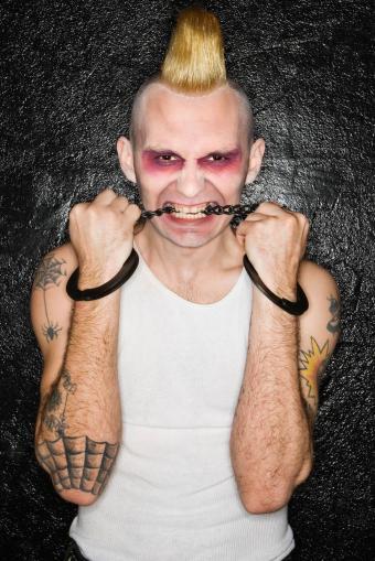 https://cf.ltkcdn.net/tattoos/images/slide/234868-567x850-spider-web-elbow-tattoo.jpg