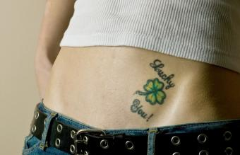 Woman with lucky you tattoo