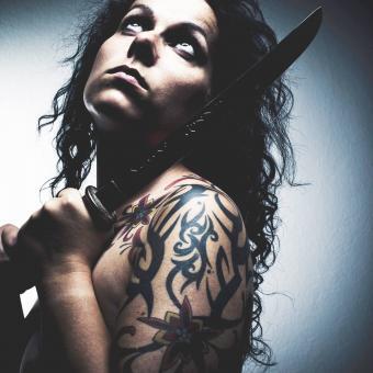 https://cf.ltkcdn.net/tattoos/images/slide/248631-850x850-12-awesome-tribal-armband-tattoos.jpg