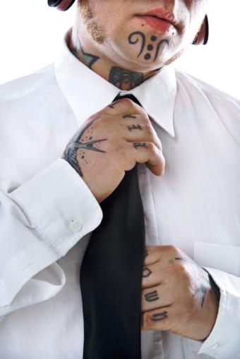 https://cf.ltkcdn.net/tattoos/images/slide/50316-566x848r1-tattoos-around-neck.jpg
