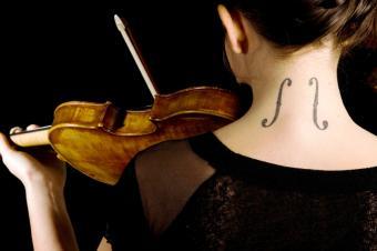 https://cf.ltkcdn.net/tattoos/images/slide/50321-849x565r1-music-tattoo-on-neck.jpg