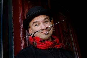 Man with facial piercings