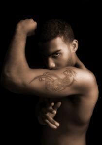 Man doing karate with dragon tattoo
