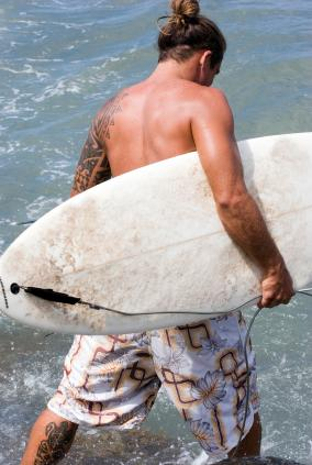 Surfer with hawaiian tattoos