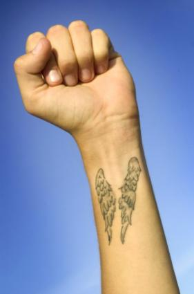 Angel wings on inner wrist