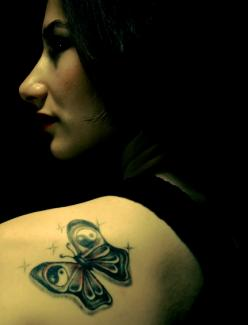 Butterfly tattoo with ying yang symbols