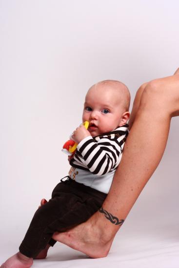 Baby sitting on feet