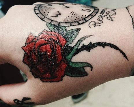 hand rose tattoo