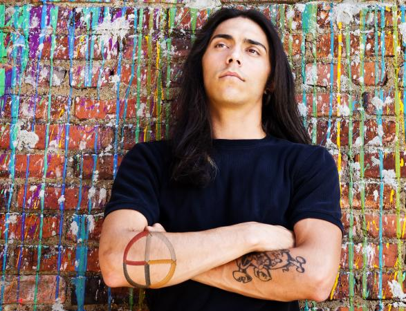 man with medicine wheel tattoo
