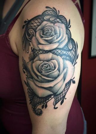 Roses on black lace shoulder tattoo