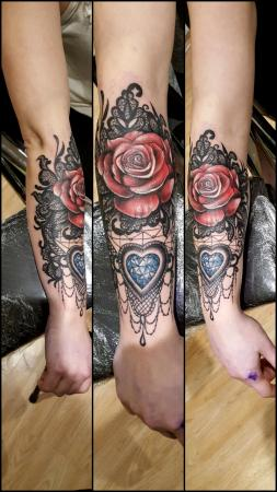 Tattoo of a rose and heart-shaped diamond on lace