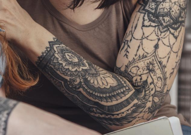 Image of woman's black lace tattoo sleeve