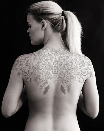 Woman's large floral lace back tattoo