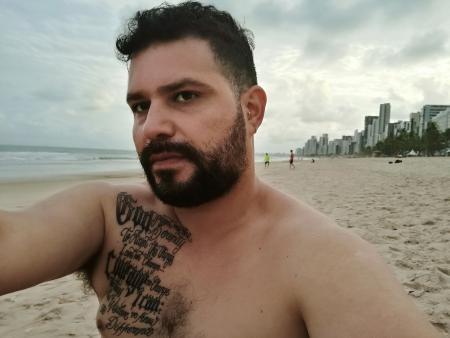 Man with serenity prayer chest tattoo