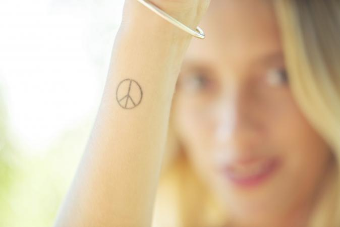 Woman with peace sign tattoo
